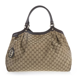 brown-monogram-fabric-leather-handbag